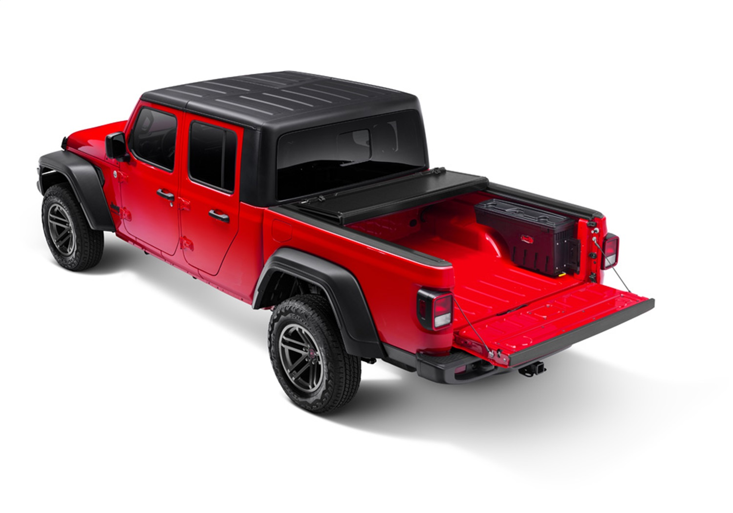 An undercover Swingcase mounted on the Passenger Side truck bed of the Jeep Gladiator