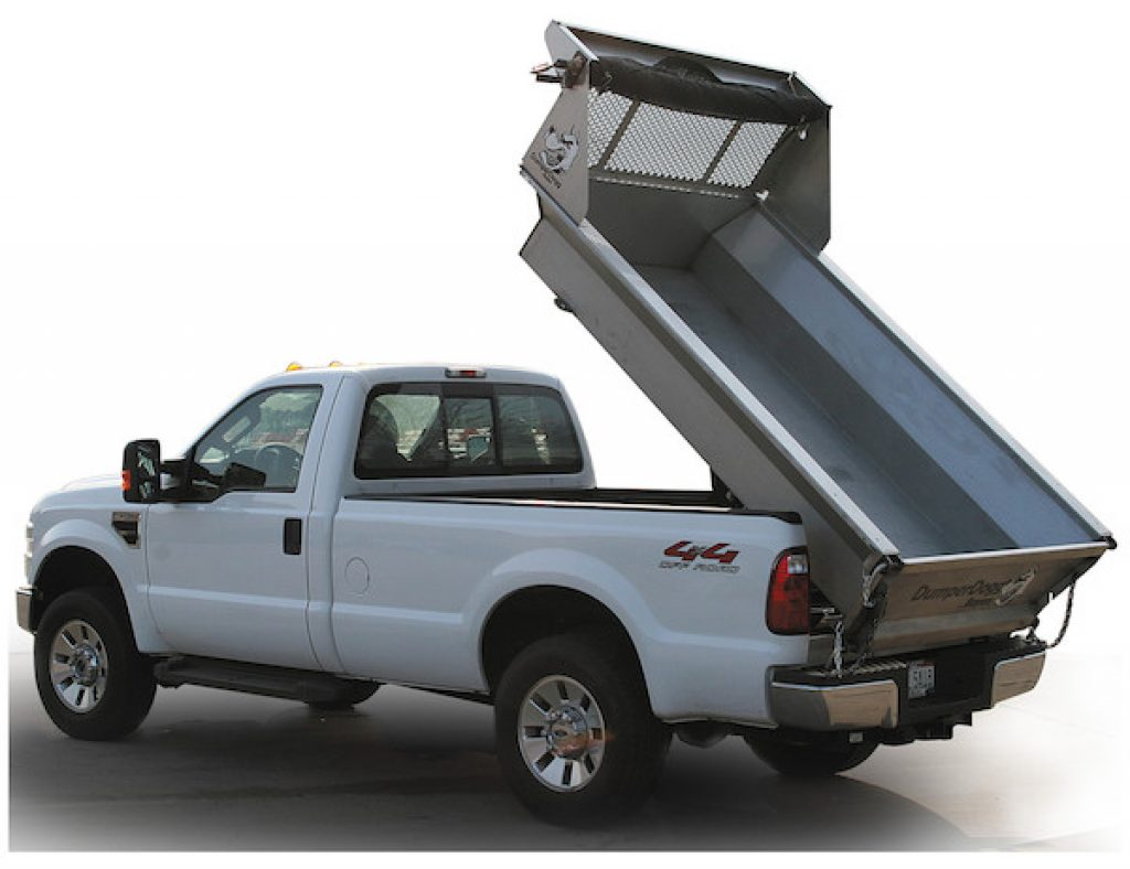Pickup Truck with a DumperDogg Dump Box Kit installed. Dump Box as shown is in a raised position.